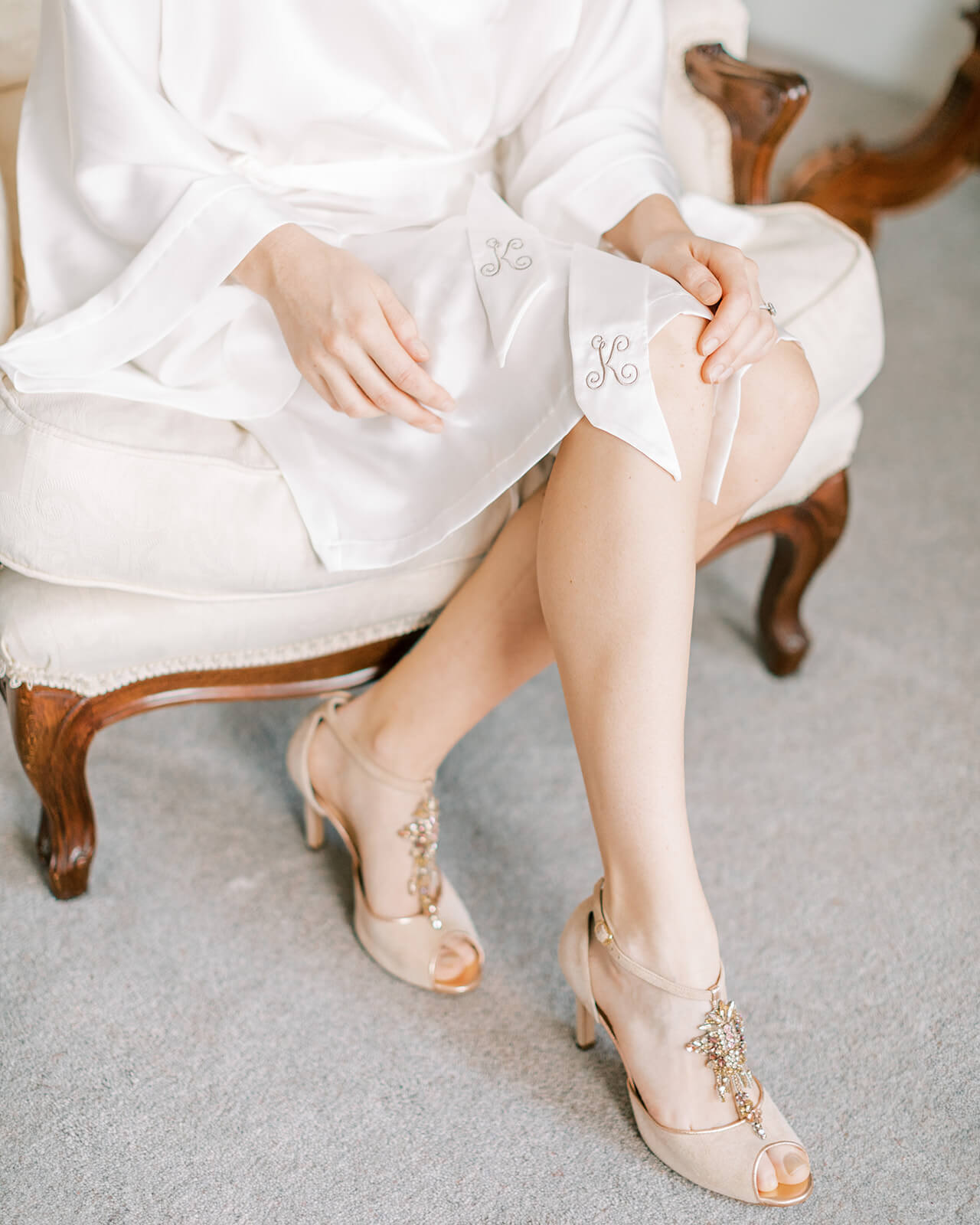 Tutti Frutti blush and gold wedding sandals shown on a models feet