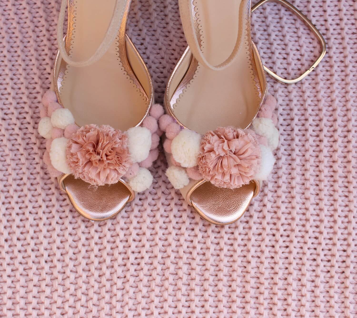 pink and gold peep toe sandals with pom pom embellishment