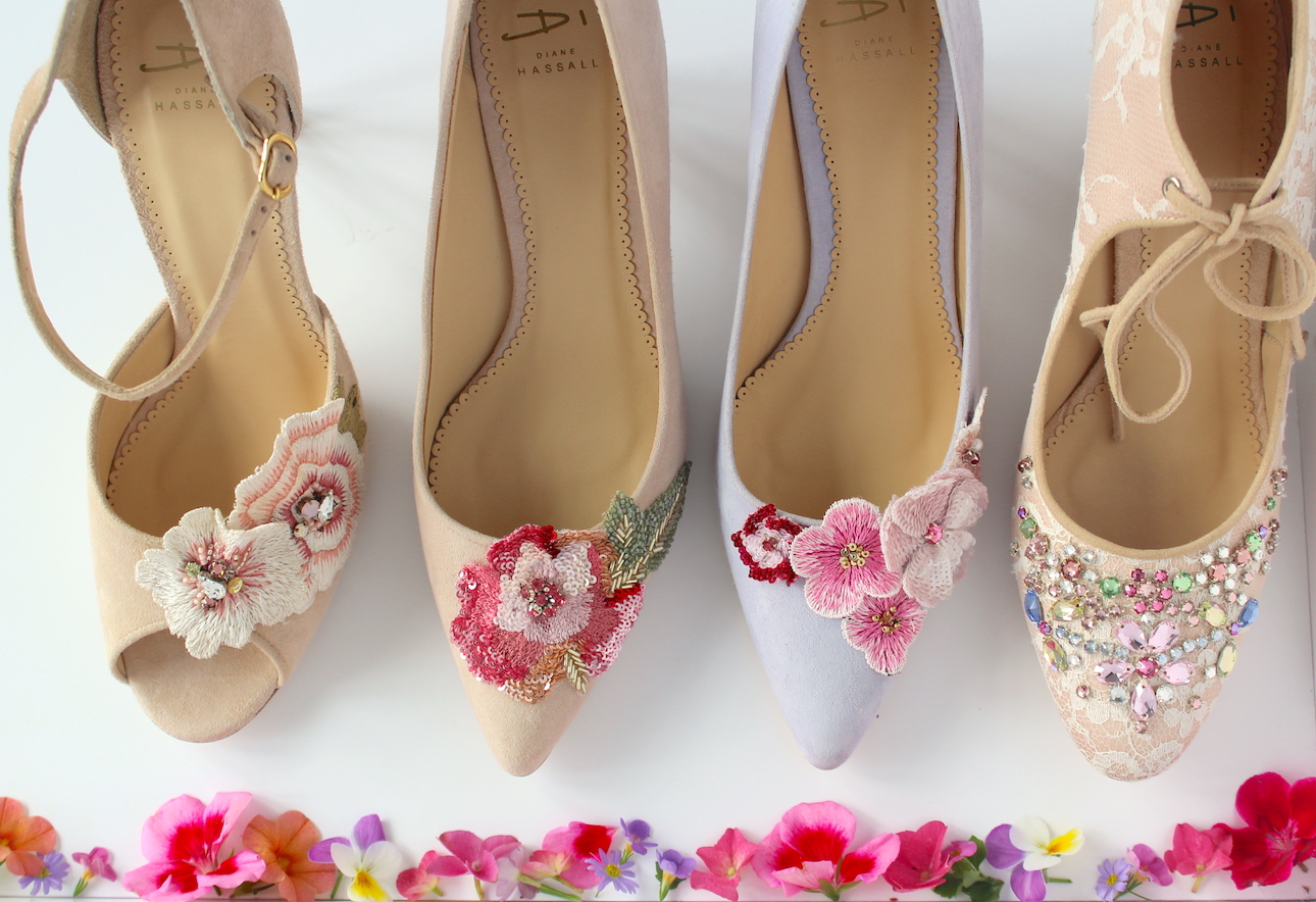 four floral embroidered shoes