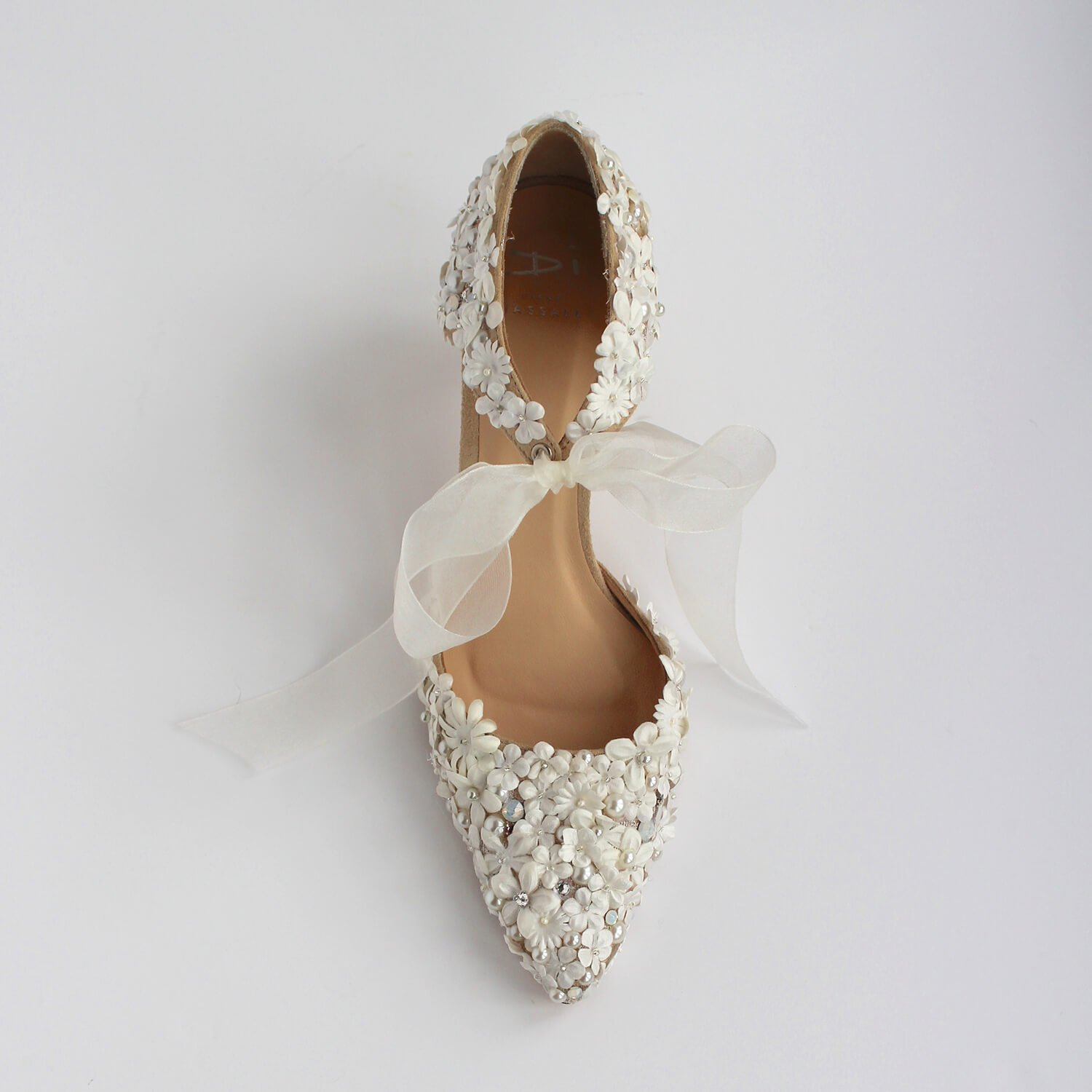 Blush and ivory low heeled wedding shoes with tie front fattening